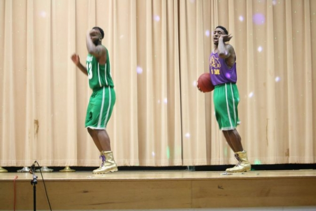 Two basketball players on stage